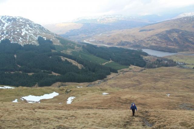 Allan D heading up Ben More with Loch Dochart below