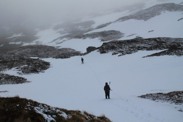 Marie H & Howard N on the way back down the north east ridge of Ben More