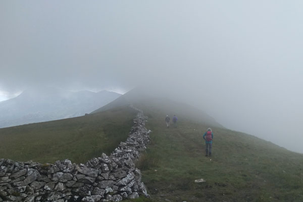 walkers in the mist on a mountain