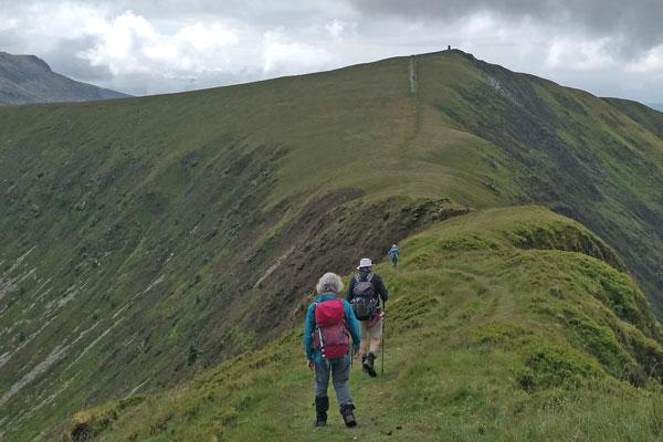 walkers on a mountain ridge