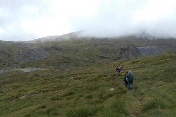 walkers on moorland near old mine workings
