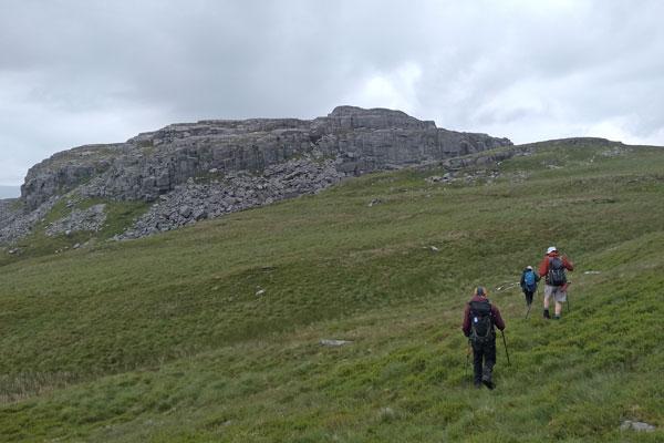 walkers approaching rocky mountain